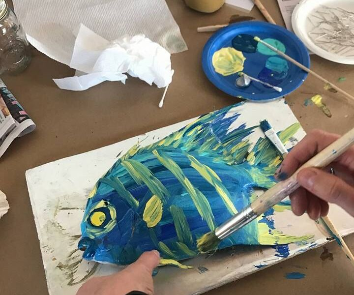A colorfully painted fish craft